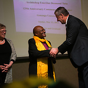 Trustee Emeritus Tom Tilford and his wife, Camilla Tilford, present a commemorative 125th Anniversary Medallion to Archbishop Tutu at the honoree dinner.