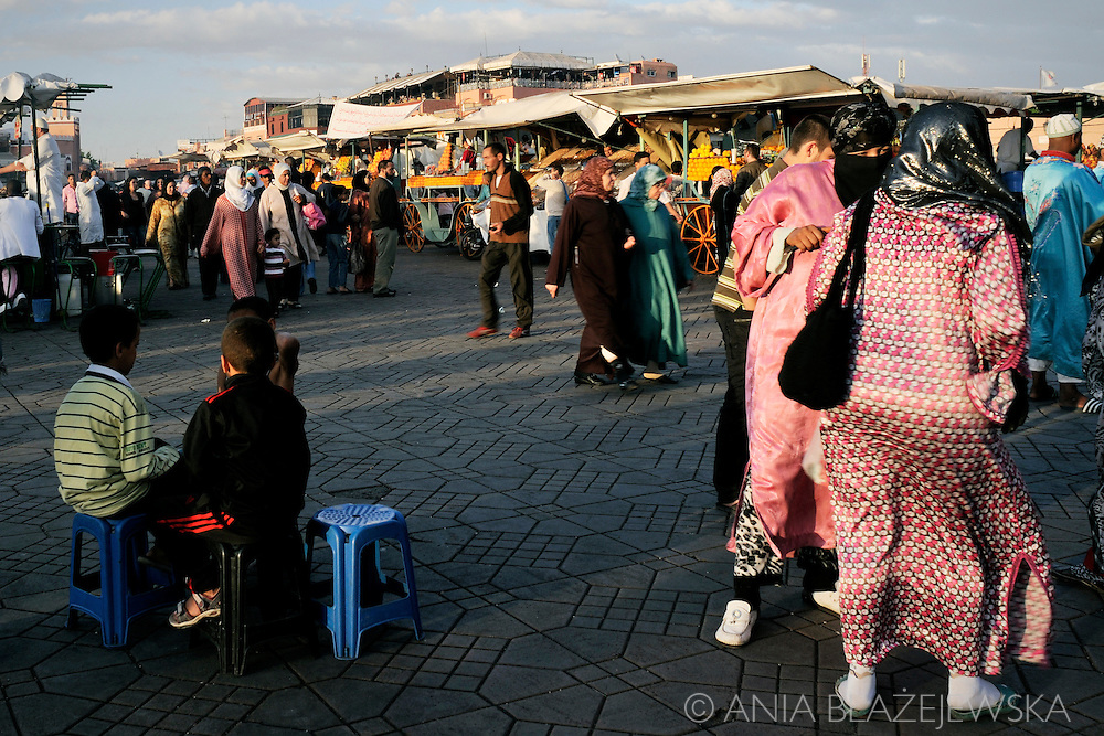 Morocco, Marrakesh. People in Djemaa el Fna during a late afternoon.