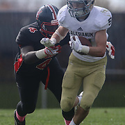 Salesianum running back Zachary Jarome (31) gains extra  yards as William Penn defensive end Frank Burton attempts to defend in the second quarter during a regular season football game between No. 2 Salesianum and No.1 William Penn Saturday, Oct. 31, 2015 at William Penn High School in New Castle.