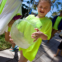 NAPLES, FL -- March 13, 2010 -- Abby Hedrick, 6, of Summit, Jersey, gets hit in the face with water from a fish tanks she carried from the beach after collecting clams and fish during the Nature's Wonders program at The Ritz-Carlton in Naples, Fla., on Saturday, March 13, 2010.  The three hour programs let kids experience a more involved, educational nature program while parents get free time to enjoy themselves sans kids.