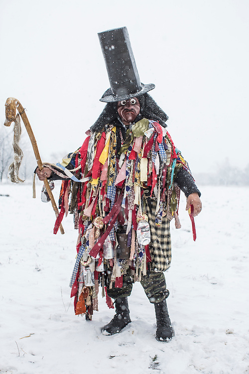 Ivan Burachuk, 34, dressed in the costume of a Jew, poses for a portrait during celebrations of the Malanka Festival on Thursday, January 14, 2016 in Krasnoilsk, Ukraine. The annual celebrations, which consist of costumed villagers going in a group from house to house singing, playing music, and performing skits, began the previous sundown, went all night, and will last until evening. According to tradition, married men are only able to take part in Malanka wearing a mask.