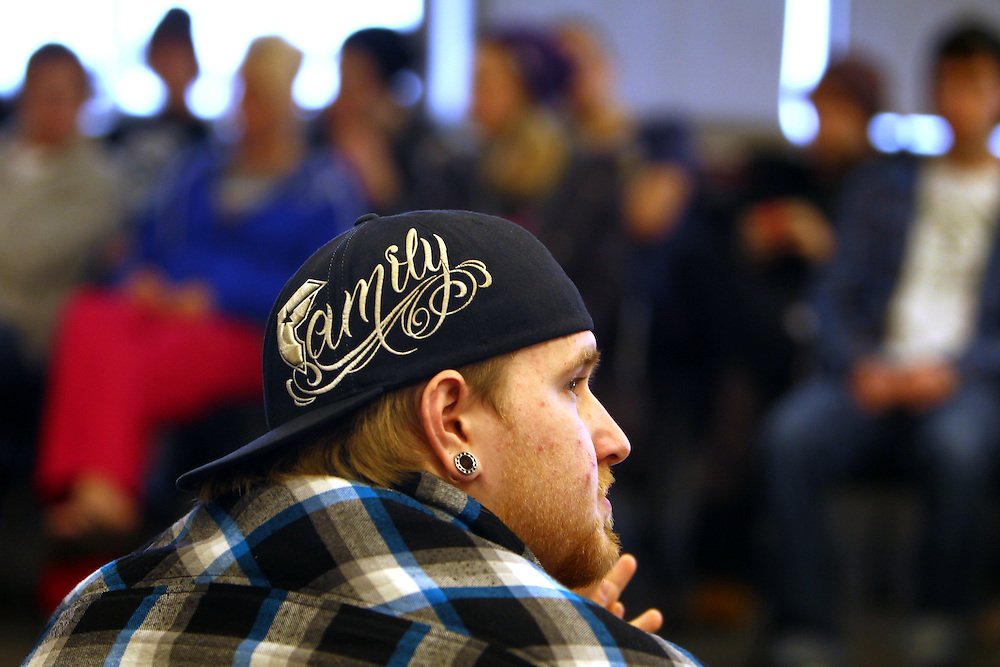 "3/7/11 5:15:13 PM -- Minneapolis, MN, U.S.A.---.James ""Bear"" Mahowald, 21, of Hastings, MN, used the word on his hat--""family""--to describe what unity means to him during a StepUP all-house Circle meeting at Augsburg College in downtown Minneapolis March 7, 2011.  Residents gather weekly to discuss housing issues, talk about upcoming events and check in with each other on their journeys in recovery..---.Photo by Courtney Perry, Freelance."