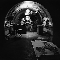 Mural painter Cliff Young works on the vaulted ceiling of a hallway in the U.S. Capitol.