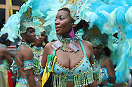 The 44th annual West Indian Carnival Parade winds its way along Eastern Parkway in Brooklyn. A crowd of a million celebrate Caribbean culture with costumed dancers and Calypso and Soca music.