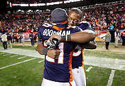 SHOT 1/8/12 7:14:19 PM - The Denver Broncos Demaryius Thomas #88 hugs teammate Andre Goodman #21 after Thomas scored the game winning touchdown in overtime against the Pittsburgh Steelers during their AFC Wildcard game at Sports Authority Field at Mile High on Sunday January 8, 2012. The Broncos won the game in overtime 29-23. (Photo by Marc Piscotty / © 2012)