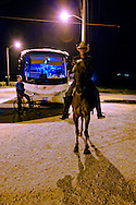 Cowboy and bus in Mayari, Holguin, Cuba.