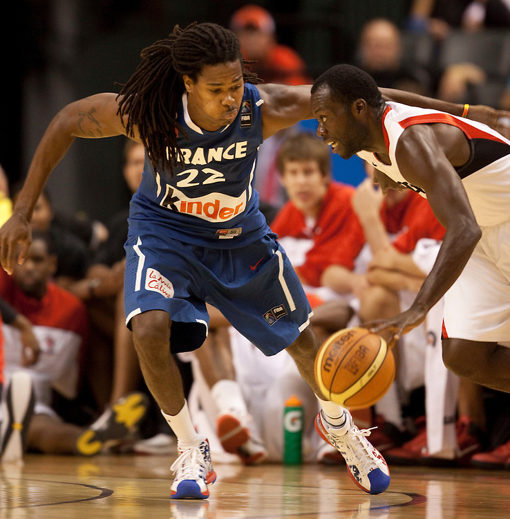 [filename} -20100812- Toronto, Ontario,Canada<br /> France's Mickael Gelabale defends against Canada's Denham Brown during the first half of a game in the 2010 Jack Donohue International Classic in Toronto, Canada, August 12, 2010.<br /> AFP PHOTO/Geoff Robins