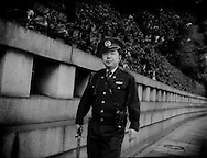 Because Yasukuni War Shrine is so internationally and domestically contraversial, Japan National Police patrol the shrine and its perimeter.  Tokyo, Japan.