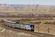 Amtrak's eastbound California Zephyr rounds a big curve shortly after leaving the station at Green River, UT.