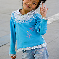 Portrait of a young Chinese Mongolian girl in the town square of Bayan Ul Hot, Inner Mongolia, China.
