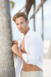 portrait of a sexy man on the beach in Florida