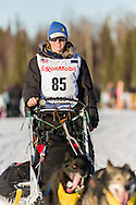 Musher Katherine Keith competing in the 44th Iditarod Trail Sled Dog Race on Long Lake after leaving the restart on Willow Lake in Southcentral Alaska.  Afternoon. Winter.