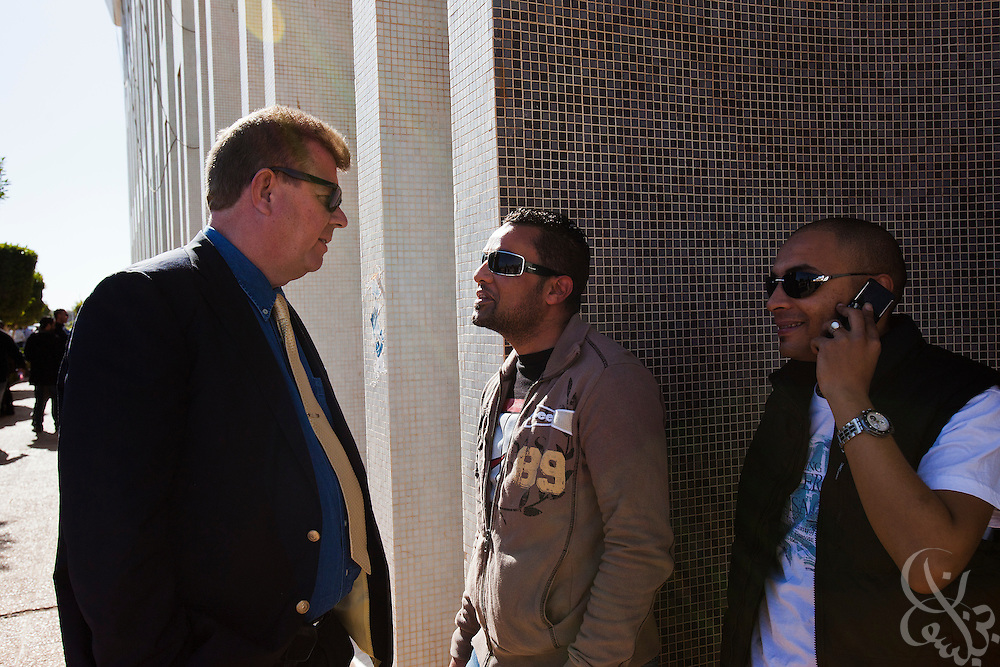 Dr. Ronald Meinardus (l), Regional Director of the Friedrich Naumann Foundation for Liberty (FNF) listens to Libyan students describe life since the revolution on the Benghazi University campus in  Benghazi, Libya December 18, 2011.  (Photo by Scott Nelson, for Der Spiegel)