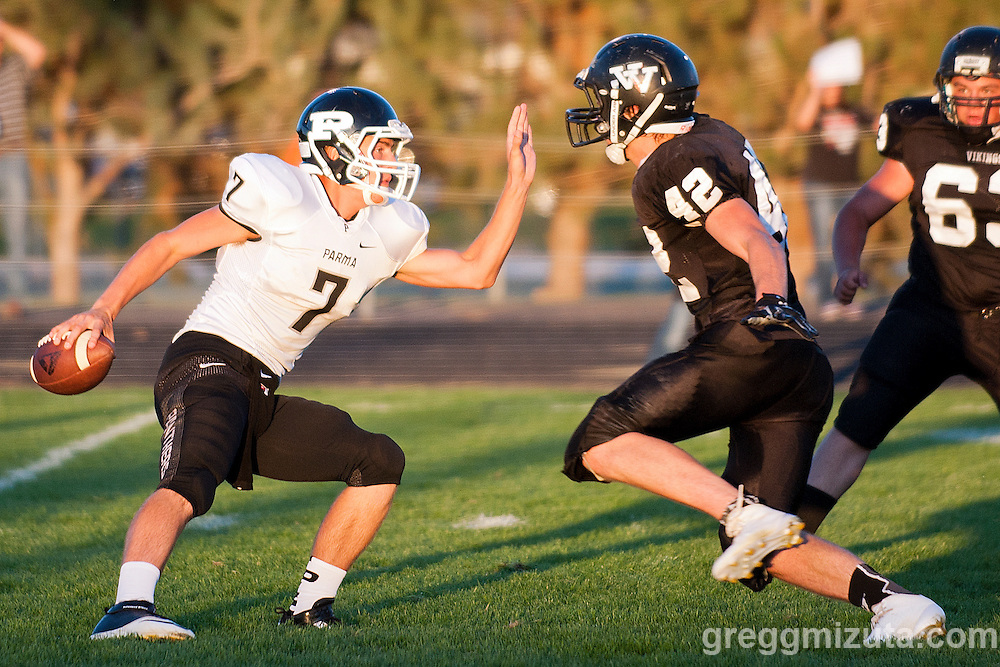 Vale's Sage Delong and Caleb VanAmringe pursue Parma quarterback Aaron Hezeltine during the Vale - Parma football game, September 5, 2014 at Frank Hawley Stadium, Vale High School, Vale, Oregon. Vale won 48-7.
