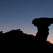 Camel Rock, a rock formation that resembles a sitting camel, is rendered in silhouette just after sunset on the Tesuque Pueblo near Sante Fe, New Mexico.