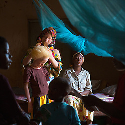 Children spend time together after school in their dormitory at the Kabanga Protectorate Center and School in Tanzania. Residents with albinism make up roughly one-third of the center's population—and 60 percent of them are children. Though violence against children and adults with albinism has been a problem, these kids face an even greater threat: Skin cancer kills 98 percent of Tanzanians with albinism before they reach the age of 40.