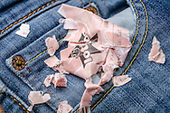 London, England - January 26, 2016: Washed Lottery Ticket in Pocket of a Pair of Jeans, The National Lottery is operated by Camelot Group since the first draw in November 1994.