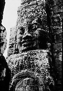 A giant stone face of Bayon. The faces may represent  Loksvara, Mahayana Buddhism's compassionate Bodhisattva, or perhaps a combination of Buddha and Jayavarman VII.