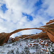 Landscape Arch, the largest natural arch in the world, is located in Arches National Park, Utah. The arch spans 290 feet, according to the Natural Arch and Bridge Society. Landscape Arch, seen here dusted by snow, was formed by repeated freezing and thawing.