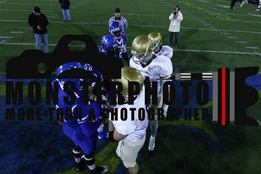 Middletown and Salesianum meet at midfield prior to the start of the DIAA Division I State Championship football game between Middletown and Salesianum Saturday, Nov. 30 2013, at Delaware Stadium in Newark Delaware.