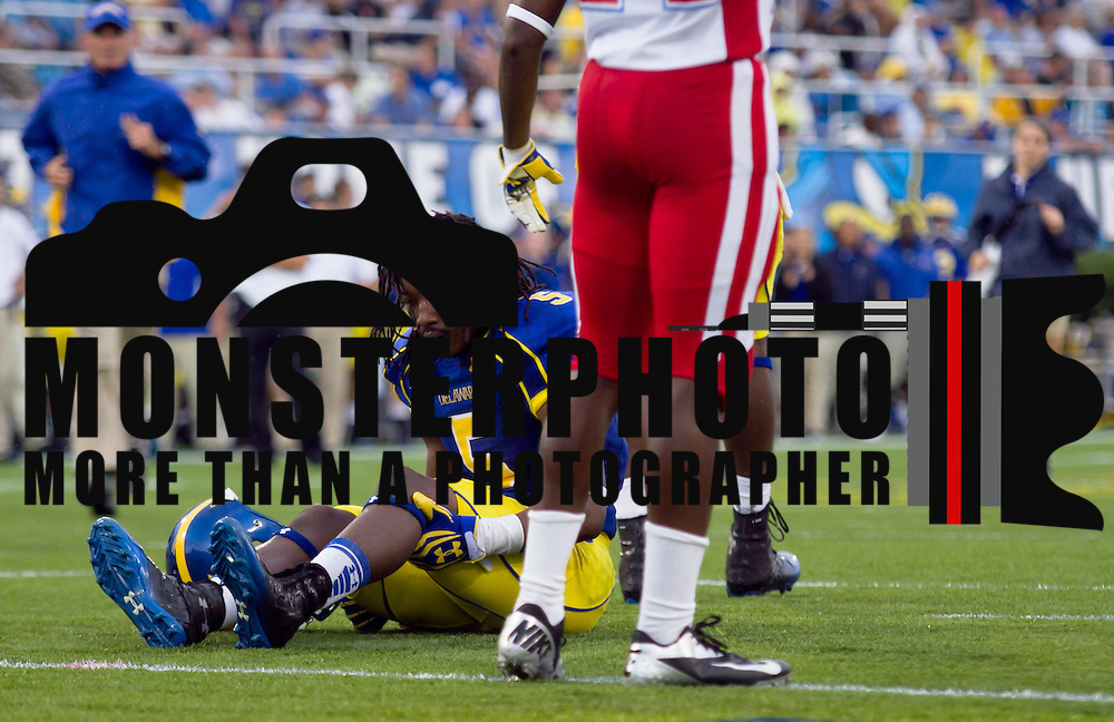 Delaware Wide Receiver Rob Jones (5) sits on the field injured after taking a low hit to his lower leg during a Week 2 NCAA football game against Delaware State Saturday Sept. 08, 2012 in Newark Delaware...It would be later learned the Delaware Wide receiver Rob Jones (5) broke his ankle, and may be done for the season.