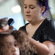 04/20/12 Newark Del. Stylist Jessica Romanl works on model Lina Romanl hair during a dress rehearsal Friday, April. 20, 2012 at The Paul Mitchell school of Delaware Friday, April. 20, 2012 in Newark Del...Special to The News Journal/SAQUAN STIMPSON