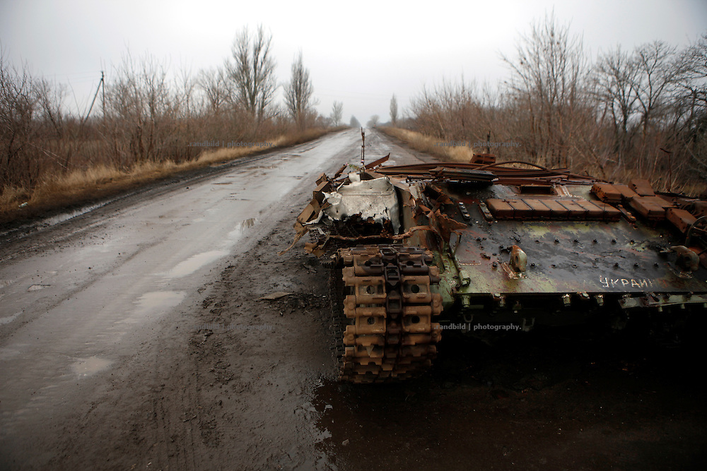 A a destroyed ukrainian T64 tank at the roadside on a road leading to Donetsk.