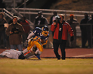 Oxford High's Glenn Gordon (11) runs vs. Jackson Callaway's Ronald Walker (1) in a MHSAA North 5A playoff game in Oxford, Miss. on Friday, November 29, 2013. Oxford won 23-7 to advance to the Class 5A championship game against Picayune.