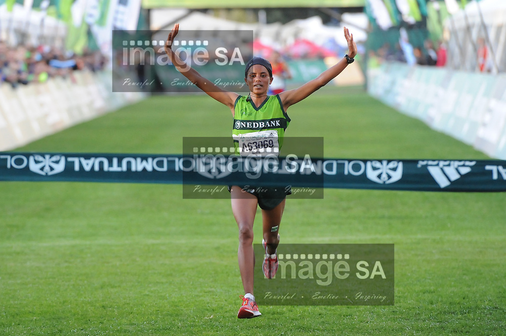 CAPE TOWN, South Africa - Saturday 30 March 2013, Biru Meseret Mengistu coming in first place for the women's race during the half marathon of the Old Mutual Two Oceans Marathon. .Photo by Roger Sedres/ ImageSA
