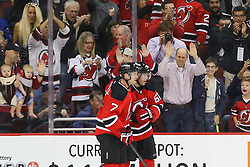 Oct 21, 2014; Newark, NJ, USA; New Jersey Devils defenseman Jon Merrill (7) and New Jersey Devils right wing Jaromir Jagr (68) celebrate Jagr's goal during the first period at Prudential Center.
