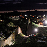 The border wall is illuminated at night in Nogales, AZ on Friday, July 6, 2012.  The president-elect of Mexico, Enrique Peña Nieto, stated  that he wants to expand his country's drug-war partnership with the United States but that he would not support the presence of armed American agents in Mexico.(Photo by Sandy Huffaker/Getty Images)