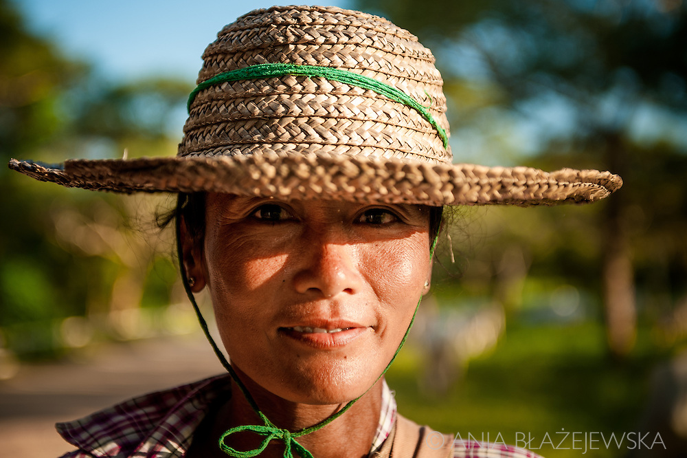 Myanmar, Bagan. Portrait of a woman wearing a hat. She's a shepherd who comes back with her herd late in the afternoon.