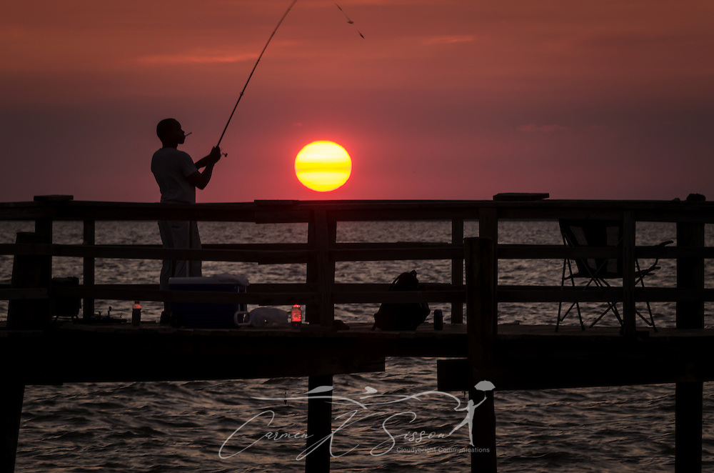 Fishing at sunset at cedar point fishing pier in cedar for Dauphin island fishing pier