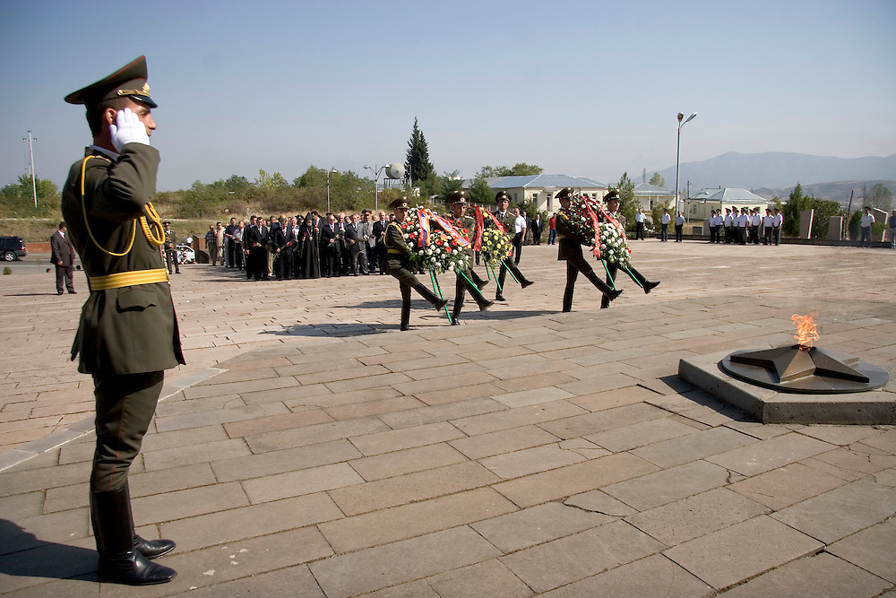 Soldiers in the Nagorno-Karabakh army perform at an Independence Day flower-laying ceremony in honor of soldiers killed in the Karabakh war.