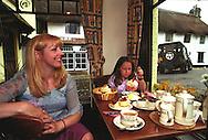 UK. Devon. Caroline Baker & her daughter Holly at Primrose Cottage tearooms, Lustleigh, Devon..Photo©Steve Forrest/Workers' Photos.