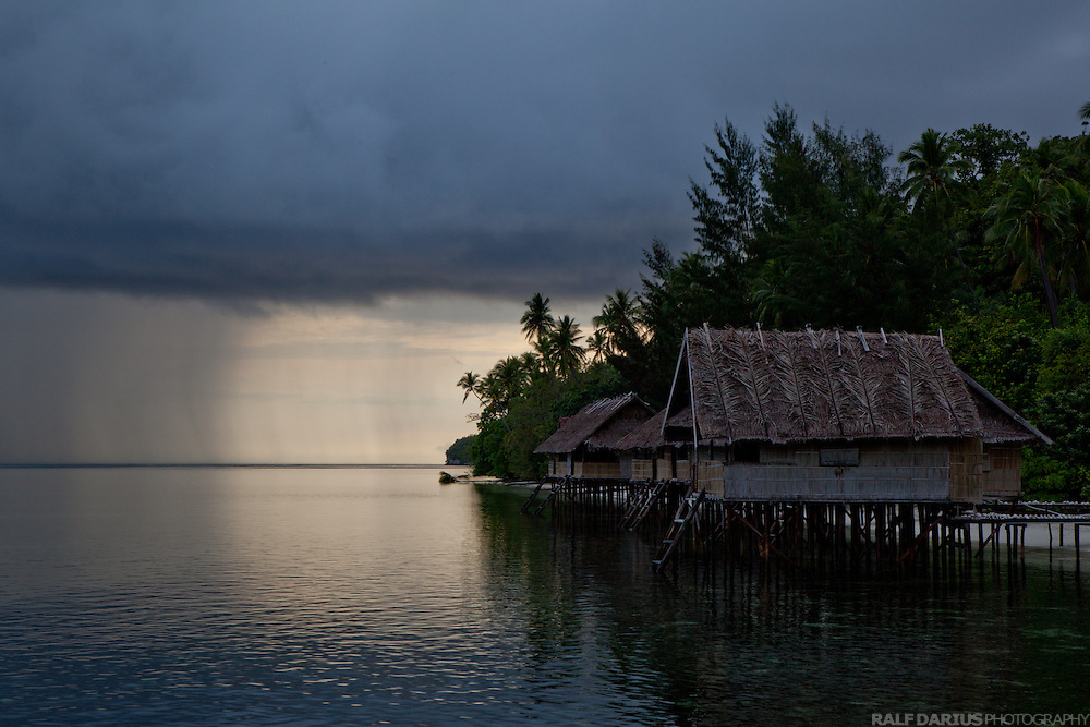 Heavy tropical rains are passing Kri Eco Resort on the island Mansuar in Raja Ampat - West Papua, Indonesia