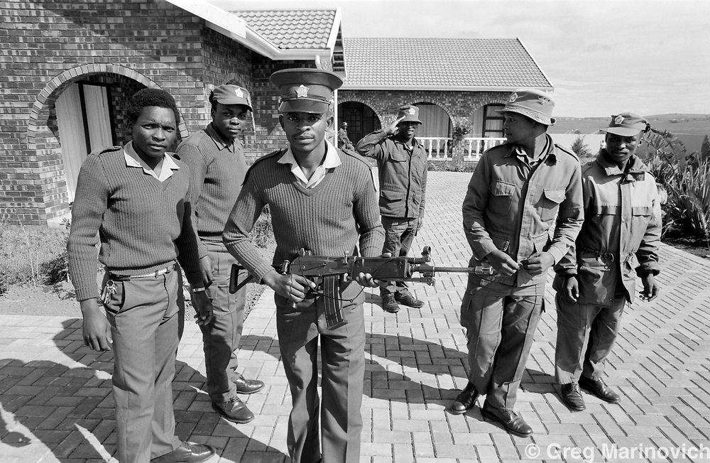 Qunu, Transkei, South Africa, 1992/3. Transkei Homeland security forces guard  Nelson Mandela's house in his birth village of Qunu, where an exact copy of the prison warder's house in which he spent the last of his imprisonment at Pollsmoor Prison built.