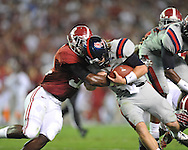 Ole Miss quarterback Bo Wallace (14) vs. Alabama linebacker C.J. Mosley (32) at Bryant-Denny Stadium in Tuscaloosa, Ala. on Saturday, September 29, 2012.