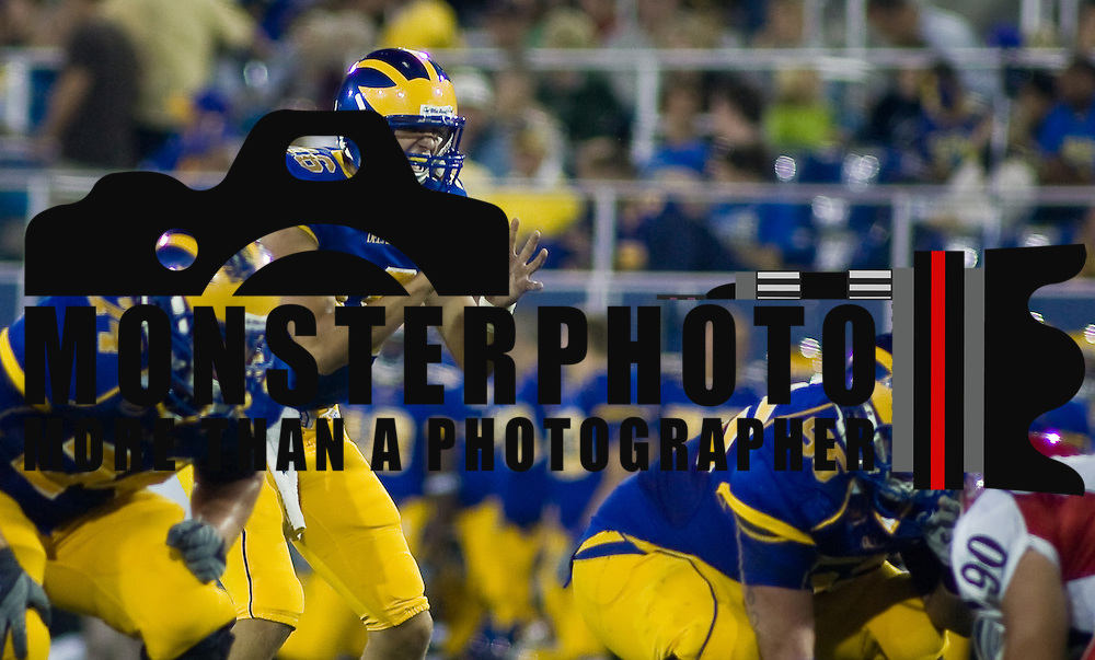 Delaware redshirt freshman QB (#16) Trevor Sasek in the 4th quarter at Delaware Stadium in Newark Delaware, as Sasek was about to win first start. Delaware defeated Duquesne 30-6 OL (#55) Will Nagle