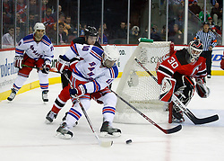 March 19, 2008; Newark, NJ, USA;  New Jersey Devils defenseman Paul Martin (7) defends against New York Rangers left wing Nigel Dawes (10) while New Jersey Devils goalie Martin Brodeur (30) looks on during the first period at the Prudential Center in Newark, NJ.
