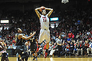 """Mississippi's Anthony Perez (13) dunks vs. Missouri at the C.M. """"Tad"""" Smith Coliseum in Oxford, Miss. on Saturday, February 8, 2014. (AP Photo/Oxford Eagle, Bruce Newman)"""