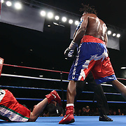 Cruiserweight boxing pro Alex Guerrero of Salisbury, Md (RIGHT) knocks down Cruiserweight boxing pro Tony Ferrante Friday, Nov 21, 2014 at The Case Center on The River Front in Wilmington, Del.