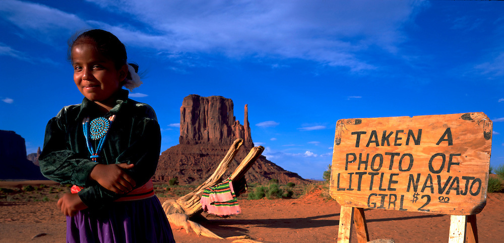 USA, Arizona, Monument Valley Tribal Reservation, Shayna Lynn Cly poses for tourists' photographs in Monument Valley