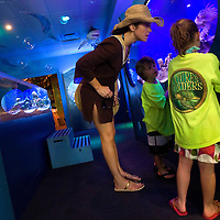 NAPLES, FL -- March 13, 2010 -- Jennifer Hedrick, of Summit, New Jersey, checks out aquariums with her children Abby, 6, and Nate, 5, as she picks them up from the Nature's Wonders program at The Ritz-Carlton in Naples, Fla., on Saturday, March 13, 2010.  The three hour programs let kids experience a more involved, educational nature program while parents get free time to enjoy themselves sans kids.