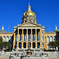 Iowa State Capitol Building in Des Moines, Iowa  <br /> Every state capitol built before WWI has a dome. The Iowa State Capitol in Des Moines is unique because it has five. The main one rises 275 feet with 23-karat gold leaf over its brick and steel structure. The smaller ones are copper, now green from weathering, with vertical braids of gold. The rest of the structure is sandstone and granite with elegant columns, carvings and arched windows. This exquisite landmark was completed in 1886. Iowa became the 29th state on December 28, 1846.