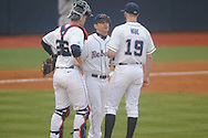 Ole Miss coach Mike Bianco (5) talks with catcher Stuart Turner (26) and pitcher Bobby Wahl (19)vs. Rhode Island at Oxford-University Stadium in Oxford, Miss. on Friday, February 22, 2013. Ole Miss won 8-1 to improve to 5-0.
