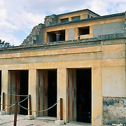 Knossos palace is partially restored at Heraklion (Iraklion), on the island of Crete, in Greece, Europe. Knossos is a Minoan archeological site associated with the Labyrinth and Minotaur of Greek mythology. The Bronze Age palace of Knossos was first built around 1900 BC, destroyed by a large earthquake or foreign invaders in 1700 BC, rebuilt more grandly, then damaged several more times by earthquakes, by invasions, and in 1450 BC by the colossal volcanic eruption of Thera (modern Thira or Santorini). Invading Mycenaeans used Knossos as their capital as they ruled the island of Crete until 1375 BC. Archaeologist Arthur Evans excavated the Palace at Knossos from 1900-1905 and named the Minoan civilization of Crete after king Minos from Greek mythology. Homer's epic poems of the Iliad and Odyssey are the first Greek literature to mention Minos as a king of Knossos, Crete. Minos was son of Zeus and Europa. Every nine years Minos made King Aegeus pick seven men and seven women to go to the Labyrinth to be eaten by the Minotaur, a creature half man and half bull. After his death, legendary Minos became a judge of the dead in Hades. The vast building complex at Knossos is popularly thought to be the site of the Labyrinth, which Greek mythology says was designed by architect Daedalus with such complexity that no one could ever find its exit. Crete is the home of Europe's first advanced civilization, the Minoan, which was contemporary with nearby advanced Egyptian and Mesopotamian cultures. Water pipes running 18 kilometers from mountains to the Knossos supplied the world's first known flush toilets and sewers by around 1500 BC, when the Minoans reached their peak. Three-story townhomes and the first known paved roads in Europe also indicate a wealthy, organized society.