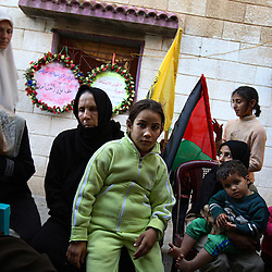 A Palestinian family is seen in Beit Hanoun, Gaza Strip, Palestinian Territories, Nov. 13, 2006. According to Human Rights Watch, since September 2005, Israel has fired about 15,000 rounds at Gaza while Palestinian militants have fired around 1,700 back.
