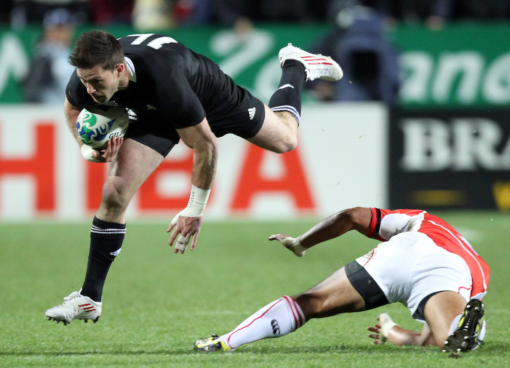 New Zealand's Cory Jane  leaps over Japan's Nozomu Fujita during a Pool A match of the Rugby World Cup 2011, Waikato Stadium, Hamilton, New Zealand, Friday, September 16, 2011.  Credit:SNPA / David Rowland