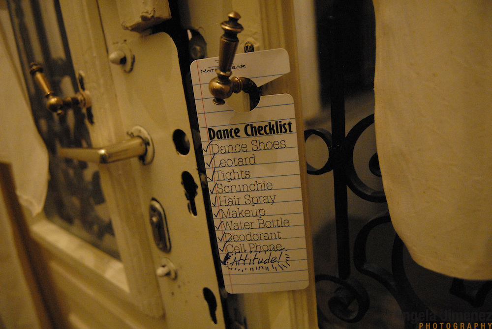 """A sign hangs on the doorknob of World Champion same-sex ballroom dancer Gergely Darabos' apartment in Budapest, Hungary on October 19, 2006. Darabos and his dancing partner, Robert Tristan Szelei, are preparing for the 2nd annual World Championship Same-Sex Ballroom Dancing competition, held in their hometown on October 21, 2006. ..Szelei and Darabos, who are known as the """"Black Swans,"""" are the reigning world champions in men?s Latin same-sex ballroom dancing. They have been training and preparing to host the 2nd annual World Championship and the Csardas Cup, the first-ever Eastern European same-sex ballroom competition, both held at the Korcsarnok arena.  This is the pinnacle event of the blossoming same-sex ballroom scene...Szelei and Darabos went on to win the men?s Standard division and finished fourth in the Latin division. ..The event was organized by the US-based World Federation of Same-Sex Dancing, which hosted the first World Championship Same-Sex championships in 2005 in Sacramento, California. The Black Swans did a large amount of the coordination and planning in Budapest, a city that had never seen an event of this kind. When government funding fell through, they secured funding from patron Desire (accent on the ?e?) Dubounet, owner of the local Club Bohemian Alibi drag club. ..The World Championship events are newly recognized, but same-sex dancers have been competing on a national and international circuit for a number of years, especially in Europe, including at the Eurogames, the Gay Games, the London Pink Jukebox Trophy and the Berlin Open, among others. Countries including the United States, the Netherlands, Germany and, now, Hungary, hold their own national same-sex championships. Hungary held its first national championships in April 2006...Szelei and Darabos spent three months at the Sacramento Dancesport same-sex dance school in California this summer, on the first scholarship offered by the World Federation. The men both got their early train"""